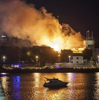 A fire is seen on the roof of Latvia's Riga Castle (AP/Dmitrijs Sulzics, F64 Photo Agency)