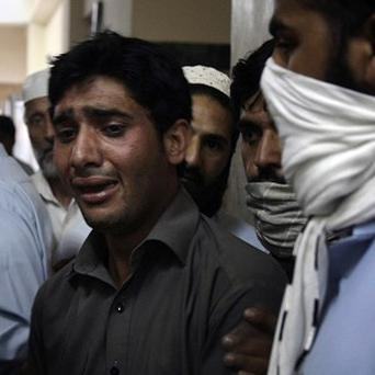 A Pakistani mourns the death of his relative after an earlier suicide bombing (AP)