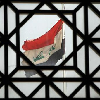 More than a dozen people were killed when a suicide bomber attacked a Shiite mosque north of Baghdad