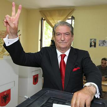 Prime Minister Sali Berisha of the Democratic Party gives a V sign as he casts his ballot during elections in Tirana, Albania (AP)