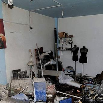 A damaged room after an explosion in Damascus which Syrian activists and state media say have killed several people (AP/SANA)