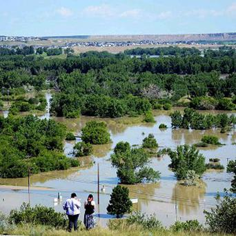 Water floods an area of the River Flats in Medicine Hat, Alberta (AP/The Canadian Press, Medicine Hat News, Emma Bennett)