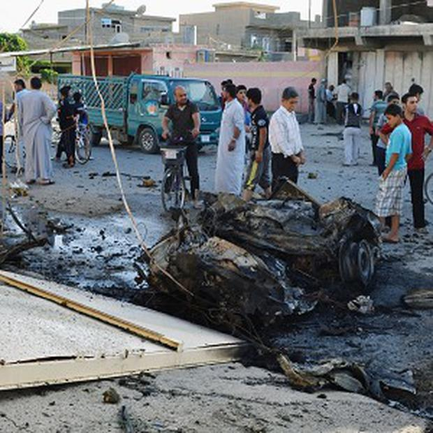 The scene after two car bombs exploded in a residential area in Tuz Khormato, north of Baghdad, Iraq (AP/ Emad Matti)