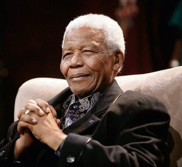 File photo of former South African President Mandela at the Nelson Annual Mandela lecture in Kliptown...Former South African President Nelson Mandela attends the sixth Nelson Annual Mandela lecture in Kliptown, near Johannesburg, in this July 12, 2008 file photo. Mandela remained in a