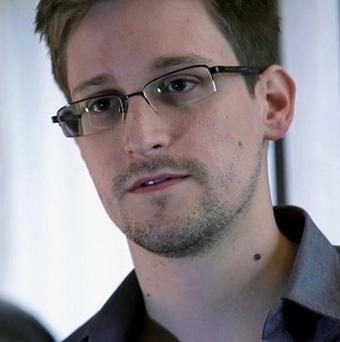 Edward Snowden admitted providing information to the news media about two highly classified surveillance programmes (AP/The Guardian)