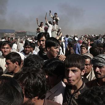 Afghans chant anti-government slogans during a demonstration in Kabul, Afghanistan (AP)