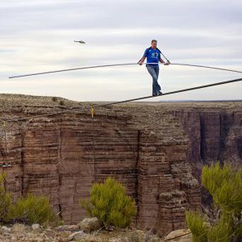 Nik Wallenda nears the completion of his tightrope walk across the Grand Canyon (Tiffany Brown/AP/ Discovery Communications)