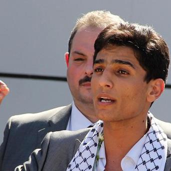 Arab Idol winner Palestinian Mohammed Assaf speaks upon arrival at the Rafah crossing point on the border between Egypt and southern Gaza (AP)