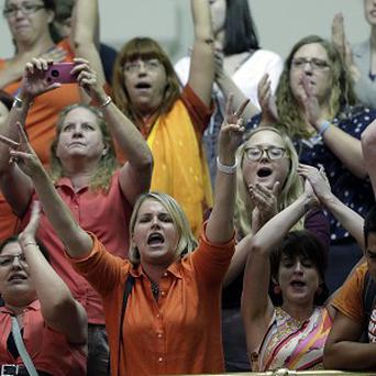 Members of the gallery cheer and chant as the Texas Senate tries to bring an abortion bill to a vote (AP)