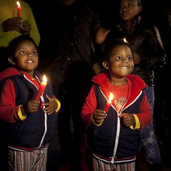 Supporters hold candles and sing Amazing Grace to show their support outside the Mediclinic Heart Hospital where Nelson Mandela is being treated (AP)