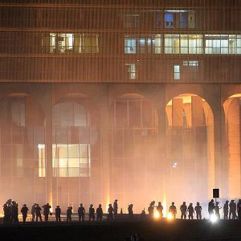 Military police guard the foreign ministry building during an anti-government protest in downtown Brasilia, Brazil (AP)