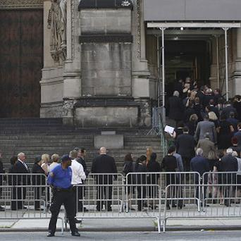 People arrive at the the Cathedral Church of Saint John the Divine for the funeral for James Gandolfini (AP)