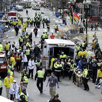 Emergency workers at the scene of the attack at the finish line of the 2013 Boston Marathon (AP)