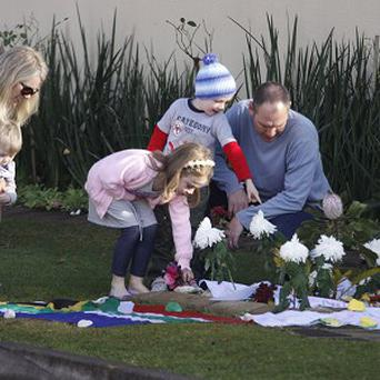 Get well wishes and flowers are placed outside the Johannesburg home of former President Nelson Mandela (AP)
