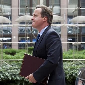 Prime Minister David Cameron arrives for an EU summit at the European Council building in Brussels (AP)
