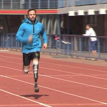 Oscar Pistorius runs at the University of Pretoria, during his first track training session since the killing of girlfriend Reeva Steenkamp. (AP/ab productions via APTN)