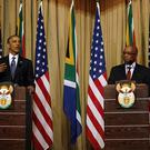 US President Barack Obama and South African leader Jacob Zuma address a press conference in Pretoria (AP)