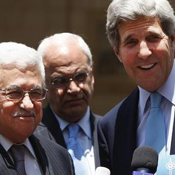 US Secretary of State John Kerry, right, and Palestinian President Mahmoud Abbas after the meeting in the West Bank city of Ramallah (AP)