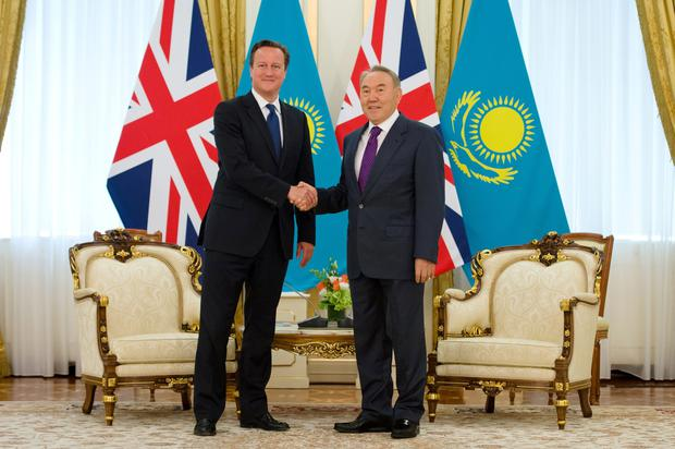 British Prime Minister David Cameron shakes hands with Kazakhstan President Nursultan Nazarbayev while on the first ever trip to the country by a serving British Prime Minister.