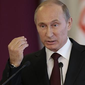 Russian leader Vladimir Putin has said Edward Snowden will have to stop leaking US secrets if he is to gain asylum (AP)