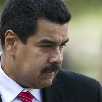 Venezuela's president Nicolas Maduro may hold the key to Edward Snowden's asylum (AP)