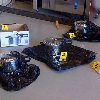 Three pressure cookers recovered outside the British Columbia's provincial legislature building (AP/The Canadian Press, Royal Canadian Mounted Police)