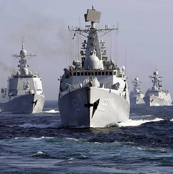 Chinese destroyer Wuhan leads a fleet of naval ships taking part in a joint exercise with Russia in the Sea of Japan (AP)