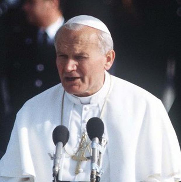 Mehmet Ali Agca, the man who shot and wounded Pope John Paul II (pictured) made a surprise visit to the saint's tomb in St Peter's Basilica.
