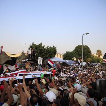 Supporters of Egypt's ousted President Mohammed Morsi carry coffins, covered with the national flag in Cairo (AP)