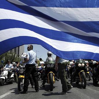 Greek municipal police officers on motorbikes protest in central Athens (AP)