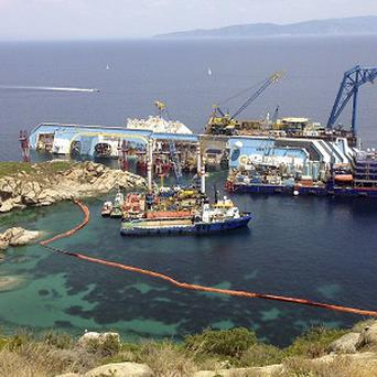 The Costa Concordia cruise ship lies on its side in the waters of the Tuscan island of Giglio (AP)