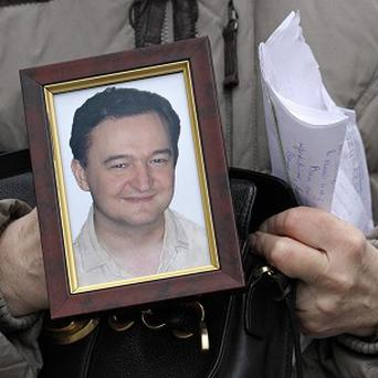 Lawyer Sergei Magnitsky, who died in jail, has been found guilty of tax evasion (AP)