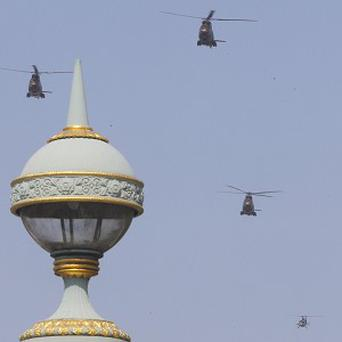 Helicopters fly in formation over the Champs Elysees Avenue during a Bastille Day celebration in Paris (AP)