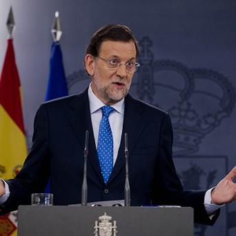 Spanish prime minister Mariano Rajoy has rejected calls for his resignation (AP)