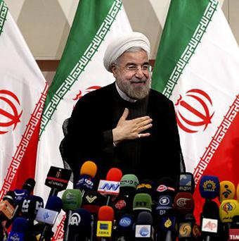 Hasan Rouhani will be sworn in as Iran's president on August 4 (AP/Ebrahim Noroozi)