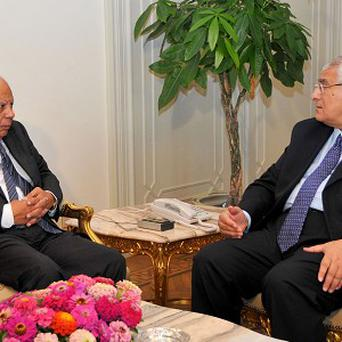Egyptian interim president Adly Mansou with prime minister Hazem el-Beblawi in Cairo (AP)