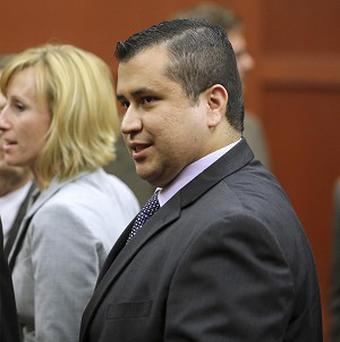 George Zimmerman leaves court after his not guilty verdict