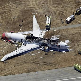 The wreckage of Asiana Flight 214 on the ground after it crashed at San Francisco International Airport (AP)