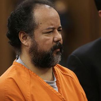 Ariel Castro stands before a judge charged with kidnapping and raping three women over a decade in his Cleveland home (AP)