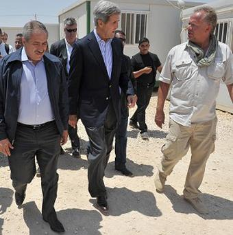 US secretary of state John Kerry tours a refugee camp near the Jordanian-Syrian border (AP)