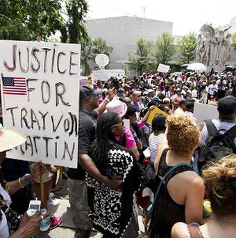 People gather in front of the federal court in Washington as they demonstrate in the Justice for Trayvon - 100 City Vigil (AP)