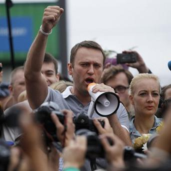 Russian opposition leader Alexei Navalny addresses supporters and journalists after arriving from Kirov at a railway station in Moscow