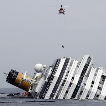The grounded Costa Concordia cruise ship off the Tuscan island of Giglio, Italy. (AP)