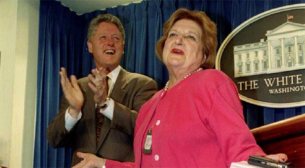 U.S. President Bill Clinton (L) applauds during a celebration of Helen Thomas' 75th birthday in the White House press room in Washington in this August 4, 1995