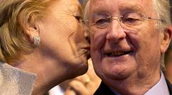 King Albert II of Belgium is kissed by his wife Queen Paola (AP)