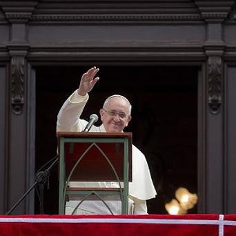 Pope Francis waves at the end of the Angelus noon prayer at Sao Joaquim Palace in Rio de Janeiro, Brazil (AP)