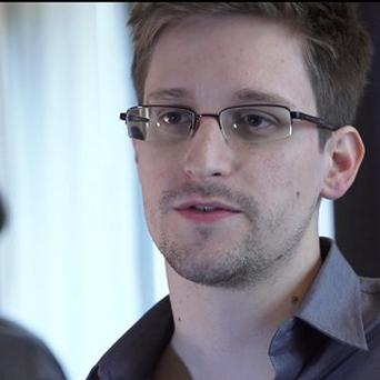Edward Snowden has left Moscow airport and entered Russia, his lawyer says (AP)
