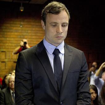 Oscar Pistorius appears at a court in Pretoria (AP)