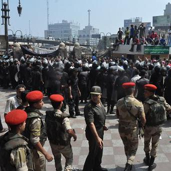 Egyptians state security and army forces provide a cordon around the al-Fatah mosque (AP)