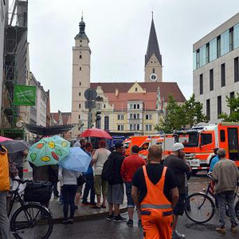 Onlookers in front of the city hall in Ingolstadt where a gunman tookhostages (AP)
